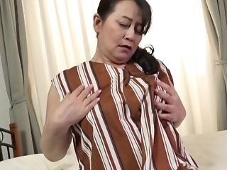 Chubby Japanese Gets Her Jummy Vulva Pleased With Her Frigs