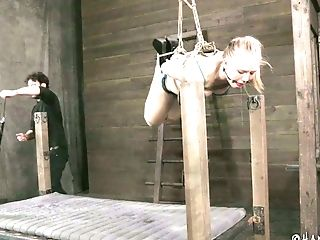 Subjugated Blondie Gets Her Puss Kittled With Fuck Stick While Being Suspended